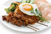 stock photo of nasi  - nasi goreng with prawn crackers and chicken satay  - JPG