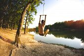 Leap From The Bungee. Jump Into The Water. A Man Is Resting On The Lake. A Swing From A Rope And A S poster