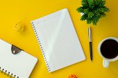 Notebook With Text Copy Space On Yellow Working Desk. Elegant Minimal Workspace Flat Lay. poster