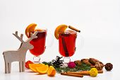 Glasses With Mulled Wine Or Hot Drink Near Wooden Deer Decoration On White Background. Mulled Wine O poster