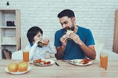Sandwich. Having Breakfast. Father. Boy. Happy Together. Man. Spends Time. Son. Father Of Boy. Engag poster