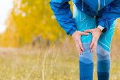 Arthritis Athlete. Injuries - Sports Running Knee Injury Woman.  Closeup Of Leg, And Knee Outdoors. poster