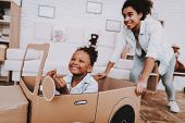 Mother And Young Girl Drive With Mother. People Play With Car. Little Girl Drive Car. Young People A poster