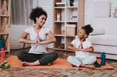 Mother With Young Girl Training. Smile Girl And Young Mother Sport For All Family. Yoga For Family.  poster