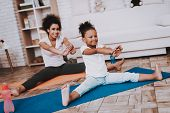 Mother And Little Girl Training Together. Studio And Sportwear. Mulatto Training Together. Mother He poster