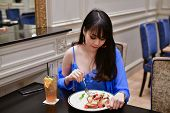 Restaurant Concept. Asian Women Eating In Restaurant. Asian Women Are Happy To Eat. Asian Women Rela poster