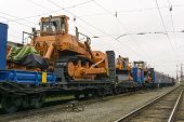 Heavy Orange Bulldozers Stands On The Flatcar Of The Train For Accident Recovery Work poster