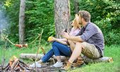 Couple Relaxing Sit On Log Having Snacks. Hike Picnic Date. Family Enjoy Romantic Weekend In Nature. poster