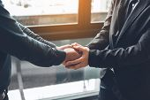 Business People Compassionately Holding Hands At Office Room. poster