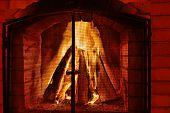 Burning Fireplace. Burning Wood In Brick Fireplace. Fireplace With A Blazing Fire. Fire In A Firepla poster