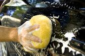 picture of car wash  - Male hand washing black car door during summer afternoon - JPG
