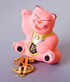 image of obeah  - maneki neko cat with golden dollar sign - JPG