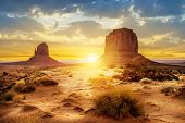 stock photo of nativity scene  - Sunset at the sisters in Monument Valley USA - JPG