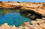 view of a natural pond of seawater in Punta de Sa Pedrera in Formentera, Balearic Islands, Spain