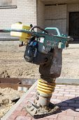stock photo of vibration plate  - Tamping Rammer at the street construction site - JPG