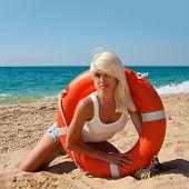 pic of lifeline  - Beautiful slim girl on the beach with a lifeline - JPG
