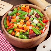 foto of lenten  - mixed vegetables in wooden bowl on kitchen table - JPG