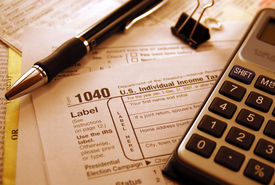 image of cpa  - IRS Tax Form with pen and calculator. ** Note: Shallow depth of field - JPG