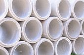 pic of sewage  - Concrete drainage pipes stacked on construction site - JPG