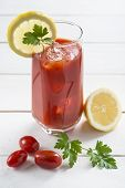 stock photo of bloody mary  - Bloody Mary cocktail garnished with a lemon slice and parsley leaves - JPG