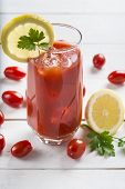 pic of bloody mary  - Bloody Mary cocktail garnished with a lemon slice and parsley leaves - JPG