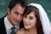 stock photo of wedding couple  - Gorgeous smiling young caucasian wedding couple portrait - JPG