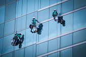 picture of high-rise  - group of workers cleaning windows service on high rise building - JPG