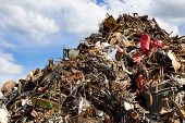 foto of wreckers  - Pile of metal waste for recycling blue sky and white clouds in background - JPG