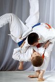 picture of judo  - Boys in judogi are training throwing judo - JPG