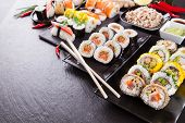 stock photo of kindness  - Various kinds of sushi food served on black stone - JPG