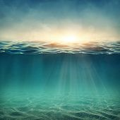 image of deep blue  - Abstract underwater background with sunbeams - JPG