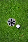 stock photo of caddy  - Golf ball and golf hole on the green grass - JPG