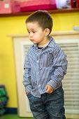 pic of montessori school  - Little child boy playing in kindergarten in Montessori preschool Class - JPG