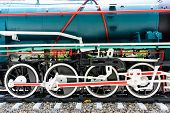 foto of hooters  - Wheels and connecting rod of old steam locomotive on railway - JPG