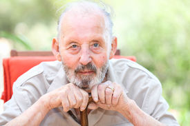 stock photo of cataracts  - happy senior with cataracts in eyes - JPG