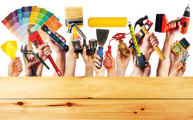 picture of handyman  - Hands with construction tools - JPG