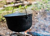 foto of cauldron  - Cooking in the cauldron on the open fire - JPG