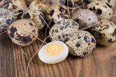 image of quail  - quail eggs lying in a wooden table - JPG