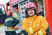 stock photo of fire brigade  - firefighter crew in uniform in front of fire engine machine and fireman team - JPG