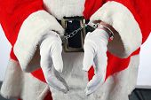 stock photo of delinquency  - Santa in Hand Cuffs - JPG