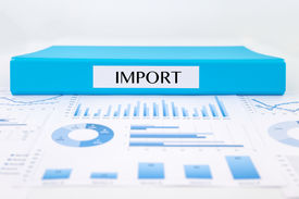 picture of summary  - Blue document binder with IMPORT word place on graph analysis of supplier purchase summary reports - JPG