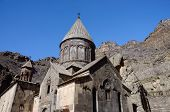 stock photo of armenia  - Geghard or Ayrivank medieval monastery surrounded by cliffs - JPG