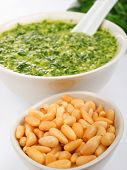 stock photo of pesto sauce  - Pesto sauce with basil and pine nuts isolated on white - JPG