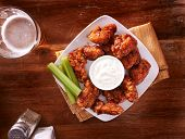 pic of chicken  - bbq buffalo chicken wings with beer ranch and celery shot top down - JPG
