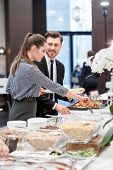 stock photo of buffet lunch  - Delighted with the opportunity to have a lunch - JPG