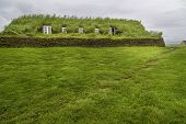 foto of iceland farm  - An old fashioned Icelandic house with a turf roof