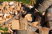 stock photo of firewood  - Old axe in log on a firewood background - JPG