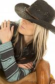 picture of cowgirls  - A cowgirl leaning on her saddle looking to the side - JPG