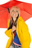 picture of rain  - A woman in her yellow rain coat hiding under her umbrella with a big smile - JPG