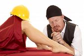 picture of pirate hat  - a woman with a hard hat on her knee and a pirate at her feet - JPG
